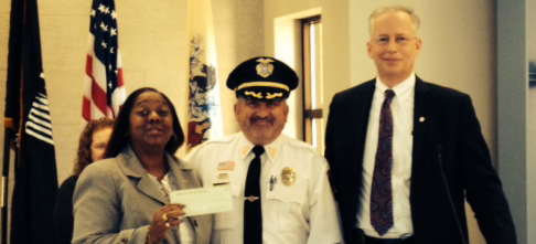 President Batelli and Foundation Chairman Rossi present donation.
